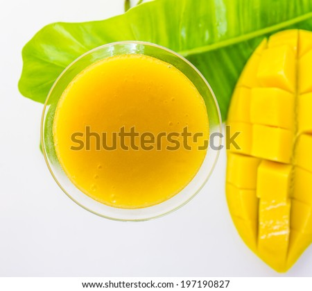 Mango juice top view on white background for design/decorate foods content.
