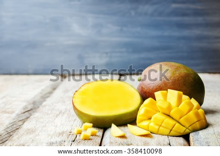 mango on a white wood background. tinting. selective focus  - stock photo