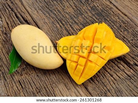 Mango on a wooden background - stock photo