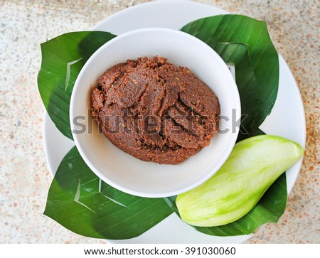 Mango on banana leaf in plate with a sweet sauce made with sugar, chilli, shrimp paste and paprika on marble table - stock photo