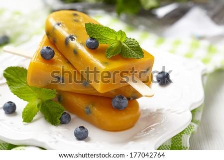 Mango Popsicles Ice Cream with Blueberry - stock photo
