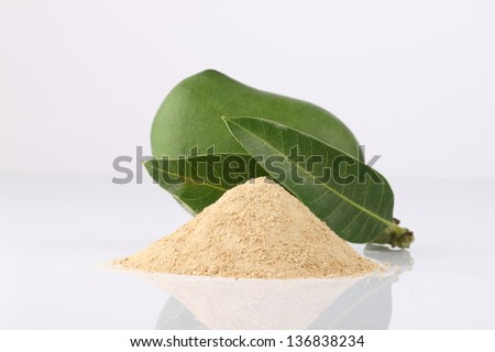 Mango Powder with green  Mango on the side - stock photo