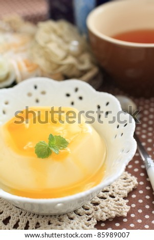 Mango pudding with freshness sauce and mint