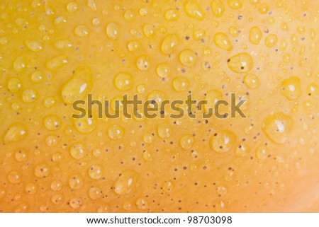Mango skin with water droplets