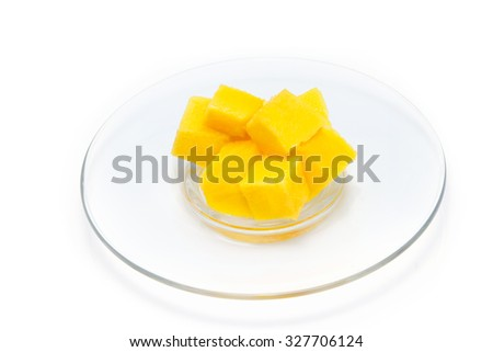 mango slice in plate isolated on white background  - stock photo