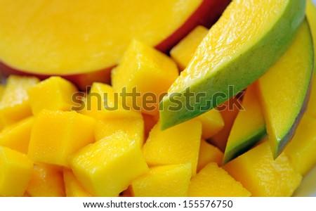 mango slice on colorful dish  - stock photo
