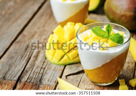 mango vanilla whipped cream dessert on white wood background.toning. selective Focus - stock photo