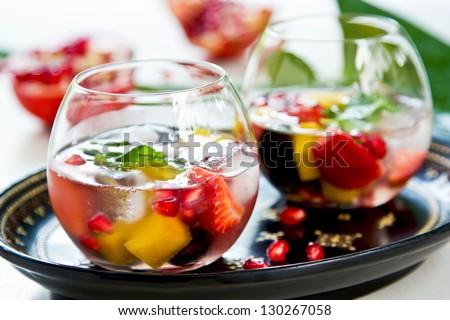 Mango with strawberry,grape and  pomegranate sangria - stock photo