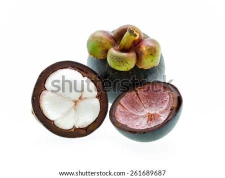 Mangosteen fruit and cross section showing the thick purple skin and white flesh of the queen of fruits.