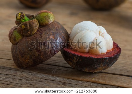 mangosteen fruit on wooden table