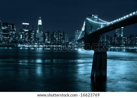 Manhattan and Brooklyn Bridge at night - stock photo