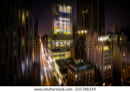 Manhattan at night. Illumination and night lights of New York City. Intentional motion blur