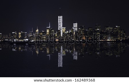 Manhattan at night, New York City skyline with reflection in Hudson River. Panorama.  - stock photo