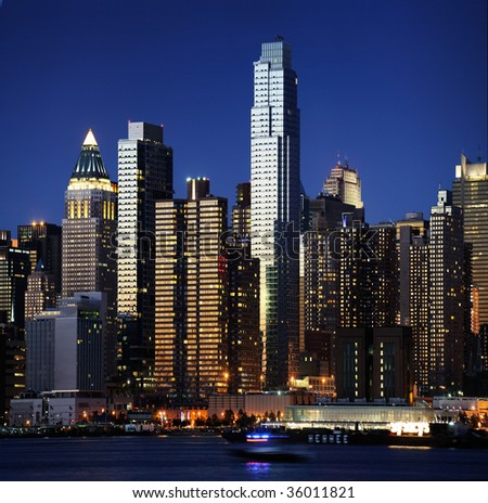 Manhattan at sunset - stock photo