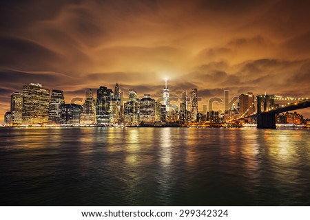 Manhattan at sunset, New York City. View from Brooklyn - stock photo