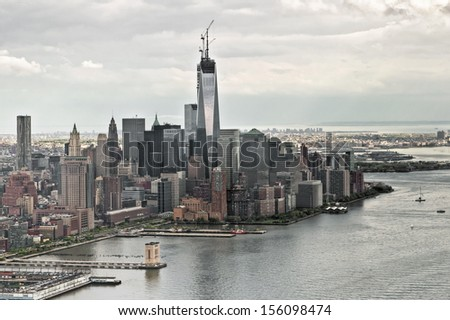 Manhattan bay from a helicopter, New York, USA. The building One World Trade Center under construction in Ground Zero Zone. - stock photo