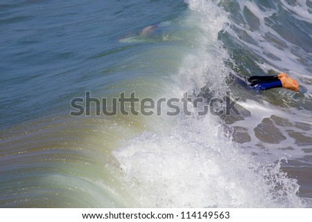 MANHATTAN BEACH, CALIFORNIA, USA - SEPTEMBER 28: Surfers enjoy large waves on September 28, 2012.  Large waves are caused by the 13th named Pacific Tropical Storm - Miriam to the south.