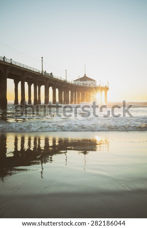 Manhattan Beach Pier California Sunset Under Pier Sunburst - stock photo