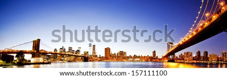 Manhattan Bridge and Brooklyn Bridge with Manhattan skyline At Night - stock photo