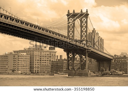 Manhattan Bridge and East River with sepia filter tone, New York - stock photo