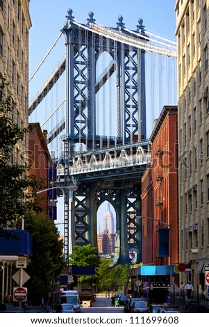Manhattan Bridge and Empire State Building seen from Brooklyn, New York - stock photo