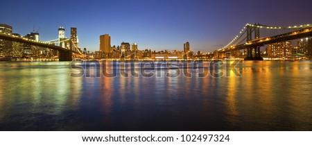 Manhattan Bridge and Manhattan skyline At Night - stock photo