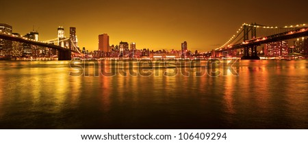 Manhattan Bridge and Manhattan skyline At Night - stock photo