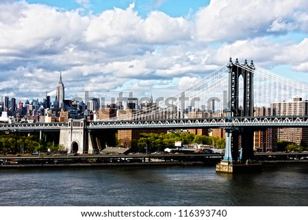 Manhattan Bridge and skyline on a cloudy day - stock photo