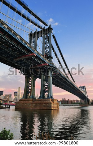 Manhattan Bridge closeup in the morning with colorful cloud over East River in Lower Manhattan in New York City - stock photo