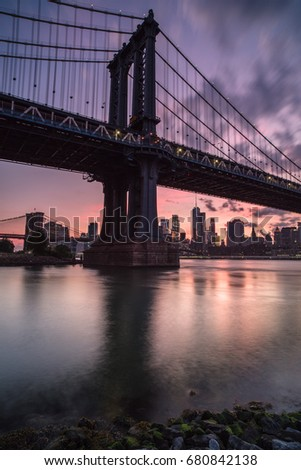 Manhattan bridge during sunset view from the rocks