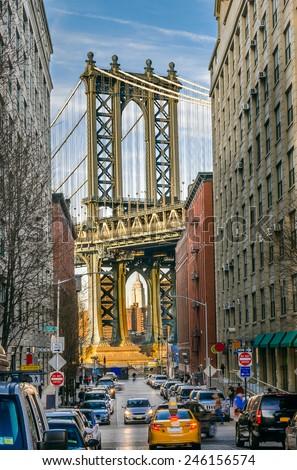 Manhattan Bridge from a Busy Street - stock photo
