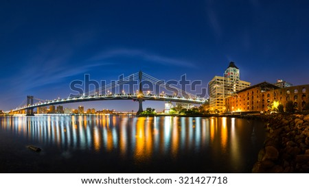 Manhattan Bridge panorama at dawn, viewed from Brooklyn Bridge park - stock photo