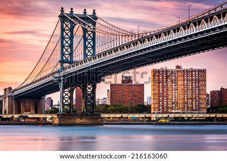 Manhattan Bridge under a purple sunset - stock photo