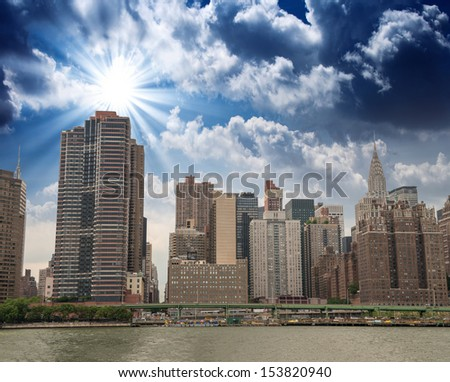 Manhattan Buildings as seen from East River - stock photo