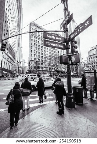 Manhattan circa dec 2014: people waiting at crossroad six av and 33 st. - stock photo
