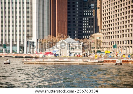 manhattan circa dec 2011: take off pier for helicopter on hudson river in new york - stock photo