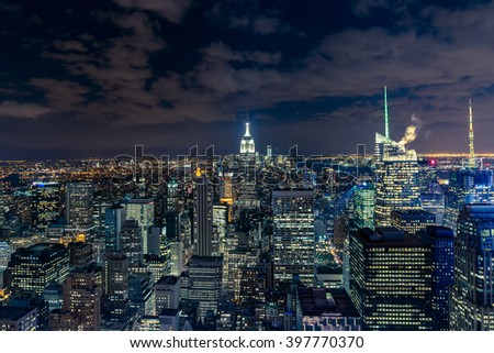 Manhattan cityscape with skyscrapers at night , New York City (aerial view)