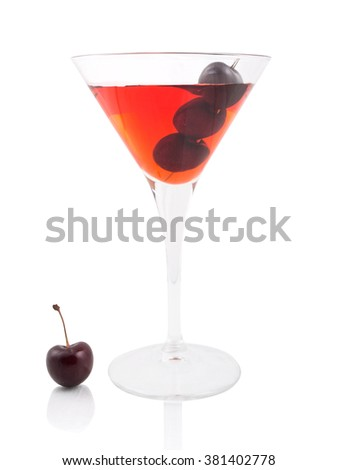 Manhattan cocktail garnished with a cherry - stock photo