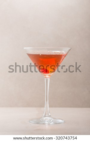 Manhattan cocktail isolated on grey background - stock photo