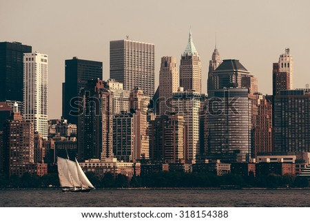 Manhattan downtown skyline with urban skyscrapers over Hudson River. - stock photo