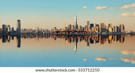 Manhattan downtown skyline with urban skyscrapers over river with reflections. - stock photo