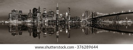 Manhattan Downtown urban view with Brooklyn bridge at night with reflections in BW - stock photo