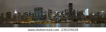 Manhattan Island at night as viewed from Long Island City. - stock photo