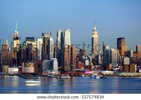 Manhattan Midtown skyline at dusk over Hudson River, New York City - stock photo