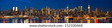 Manhattan Midtown skyline panorama at dusk, New York City - stock photo