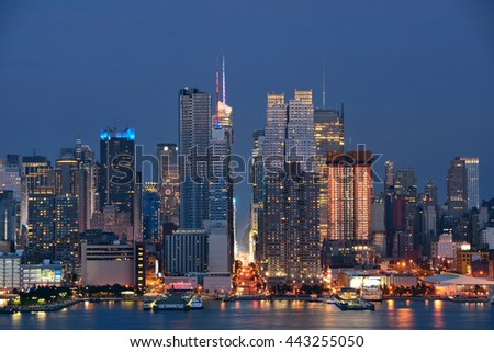 Manhattan midtown skyscrapers and New York City skyline at night - stock photo
