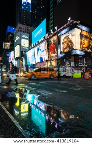 Manhattan, New York, April 8, 2016. Broadway Avenue at night after the rain. - stock photo