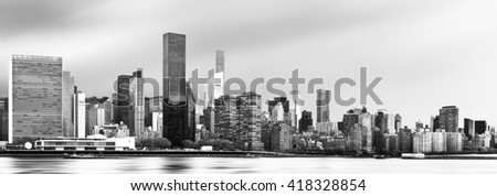 Manhattan, New York City. Black and white panoramic view of Midtown skyline across the East River on an overcast day