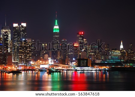 Manhattan, New York City skyline with empire state building over Hudson River at night. - stock photo