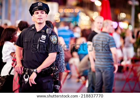 MANHATTAN, NEW YORK - JULY 3, 2011: Close up of police officer in Manhattan on July 3, 2011, New York - stock photo